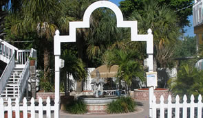Arch leading into hotel courtyard